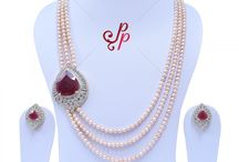 Luxury Pearl Necklace Set in Pink Pearls and Stylish Ruby Side Pendant at Rs. 7,600