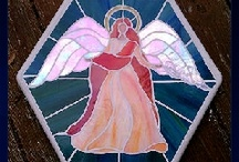 Stained glass mosaic stepping stones / Stained glass mosaic stepping stones - great for garden and patios.