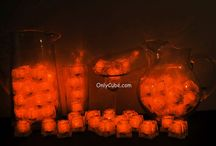 Orange LiteCubes 3 Mode Light Up Ice Cubes / Only the original LiteCubes brand! Our classic orange cubes feature 3 different modes! Fast flash, slow flash, and steady on. Clear shell with orange LEDs.