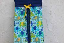 """Range-couches - Nappy bags / Ranges couches dsponibles chez """"Les sacs de génie"""""""