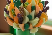 Gift Ideas for Him - Fruit Arrangements / Blossoms Fruit Arrangements are great gifts for any occasion or just because. They work in all scent free workplaces, such as offices and hospitals. they are a work of art that you can sink you teeth into!