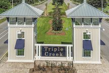 Triple Creek Community, Riverview, Florida / Triple Creek is a 1,038-acre new home, resort-style community located in Riverview, FL. Residents enjoy amenities such as a clubhouse, community pool, fitness center, sports fields, parks and playground. Complimenting the amenities is a 50-acre natural lake, wetland and preservations areas and the unusual rolling topography. Real estate located in Tampa Bay.