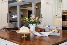 elegant kitchen dark wood island top pale grey cupboards