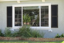 Exterior Vinyl Shutters / Vinyl Shutters are a hand-made product. Vinyl Shutters are available in a wide range of colors. The color desired is molded into the shutter panel and not just on the surface. Vinyl Shutters are built to the color of your choice and consist of a textured grain finish.