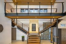 Candlewood Lake, Connecticut /  We built this unique mono stringer staircase and Keuka Style cable railing. The thick treads and curved posts are an impressive statement for the grand entry.