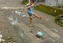 Tiny villagers do football