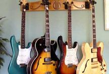 Wall Mount Guitar Hangers / These are some pics of the Pro-File™ Wall Mounted Guitar Hanger from https://www.GuitarStorage.com. MADE IN THE USA! Hang four guitars from your wall in minimal space!