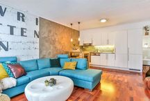 Small apartment with a blue sofa full of style