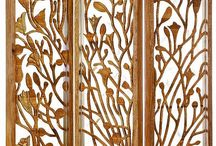 Biombo Botánica Dorada, Enredaderas Doradas 2015 collection. Colombian Filigree on Handcarved Wood. / This room divider or screen has a carefully hand-carved Lilly of the Incas plant in flor morado wood. Some of the flowers, stems and cocoons have been accentuated with hammered, gold coated silver and Colombian filigree, making this room divider an elegant piece with subtle yet noticeable shine.  The hand-carved wood and the silver and filigree accents can be appreciated on both sides of the screen.