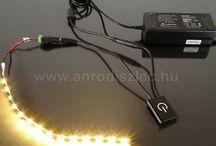 Led világításokhoz 12 voltos tápegységek / A 12 Voltos LED szalagokhoz, LED modulokhoz, LED csillagos égboltokhoz, LED izzókhoz és bármilyen 12 V DC betáplálás igénylő ledes pultvilágításhoz, mennyezeti ledes rejtett világításhoz, gipszkarton hangulatvilágításhoz szükség lesz egy tápegységre, amely megfelelő működési feszültséget biztosít a ledes eszköznek.   Az albumban több különböző gyártótól találhatunk tápegységeket, adapteres, műanyag házas, fém házas kivitelben is. Beltéri és kültéri LED trafók, akár speciális feladatokhoz is!