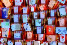 martisoare / Martisoare brodate pe fetru, decupate si lipite pe bucati de materiale tip plasa de diferite culori