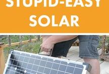 Portable solar panels hidden by library off grid veranda