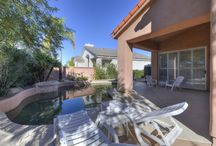 9386 N. 114th Way Scottsdale, AZ 85259 / Stonegate- Resort like living featuring a Clubhouse, Olympic –size pool, spa, walking and biking trails & 7 tennis courts. This Barcelona model home boasts 2,082 sq. ft., 3 bdrm, 2 bthrm & a split floor plan. A great rm w/ a fireplace, vaulted ceilings. White kitchen overlooking the light & bright family room. The indulgent master features dual vanities, tub, walk-in shower, private commode, walk-in closet and a private exit.Private pebble-tec pool and oversized patios.