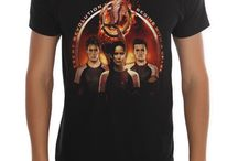 The Hunger Games / Get your gear for opening day...  All The Hunger Games: Catching Fire Buy One, Get One $1! http://shout.lt/m7sT