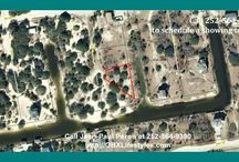 Beautiful Canalfront Lot for Sale in Outer Banks NC | 2133 Scaup Rd / Escape The Pavement and build your own get-a-way on this canal front home site with 180 feet of water frontage, easy access to the sound, and surrounded by a wide variety of wildlife including the Corolla Wild Horses. There are not many areas in the country where you can buy beach properties like this at an affordable price, so buy this lot for sale now by calling me, Jean-Paul Peron, at 252-564-9390.