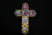 Painted Bottle Cap Cross / Each piece is hand-made and crafted. They are painted with the colors of Mexico, and made from recycled bottle caps and wood. These pieces have different images of Virgin Maria and Saints. They look great bunched together as a collection, or as a single focal piece.
