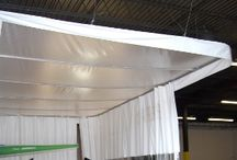 Paint Booth Enclosures / Create a safe paint booth enclosure for spray booths used in the automotive industry and other applications. Use Industrial curtains, air filters and ceiling tops to make an enclosure to help meet OSHA requirements. Find out more at http://www.amcraftindustrialcurtainwall.com/products/paint-booth-curtains/