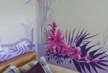 Flower Mural / This rather large floral and fauna mural was painted for a mature lady in a residential care home. She absolutely adores flowers and sitting in the garden when she can. I picked my colour pallette from the tones of the bedding and curtains within her room to create this long floral mural painting with a mix of tropical and English garden fauna.