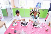 Ancient Egpyt in Year 3, October 2016 / Year 3 concluded their unit on Ancient Egypt with a day of fun activities. Students began the day making armlets and collars to add to their already spectacular costumes. They made traditional brick houses out of clay, ate a typical ancient Egyptian meal of Fattoush salad and pita bread for lunch and created collages of Pharaohs using a variety of materials. It was a perfect way to celebrate the end of this fascinating topic.