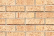 Sandstone   Triangle Brick Company / Suitable as a stand-alone brick or an accent brick, Triangle Brick Company's Sandstone special production brick features a warm buff color and subtle red accents that pair beautifully with our Red Wirecut brick and countless other products from our Downtown collection. This architectural brick is offered under our Premium tier, providing our customers with an exterior cladding option they can rely on for commercial building projects of all sizes.