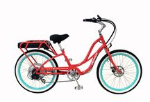 """2014 - 24"""" Step-Thru Comfort Cruisers /  The 24"""" Step-Thru Comfort Cruisers  are perfect for riders under 5'3"""" tall.   All Pedego Step-Thru Cruisers come with a throttle-activated motor, putting the rider in complete command. That rider can pedal 100% or twist the throttle to use the motor and not pedal at all (or any combination of throttle and pedaling). It's the rider's choice how hard to work on any ride."""