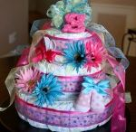 diaper cakes & shower gifts / by Heather Ohl