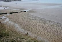 D-Day 70th Anniversary / British artists Jamie, and several volunteers, took to the beaches of Normandy with rakes & stencils to etch 9,000 silhouettes representing the fallen in the sand. Titled The Fallen 9000, the piece is meant as a stark visual reminder of those who died during the D-Day beach landings at Arromanches on June 6th, 1944. Starting with 60 volunteers, but as word spread nearly 500 additional locals arrived to help with the temporary installation lasting only a few hours before being washed away. / by PriorService.com