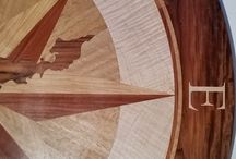 FIsher's Island Floor Medallion Compass Rose / Custom floor inlay with latitude and longitude. Made with Bolivian Rosewood, Curly White Maple, 1/4 Sawn White Oak, Hickory and Santos Mahogany.  Fishers Island in center of inlay