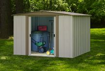 "Arrow Bedford Steel Storage Shed / Traditional, gable-roof styling combines with Arrow design and engineering features to make the Bedford tops in economical outdoor storage. ""Ride-in"" door opening and nearly 6 feet peak height make it easy to store and organize anything, from lawn and garden equipment to pool supplies and"