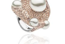 Oceania Collection / AUTORE's Oceania collection, which captivates the tropical undersea world – the birthplace of the pearl - features hand selected rare South Sea pearls combined with fancy coloured diamonds and precious stones in unusual colours and cuts. Each piece is highlighted by vibrant colour, articulation and multi function, and to hold them is to feel the creatures come alive in your hands. A story from beneath the ocean is carved in contrasting gold on the reverse side of each piece.