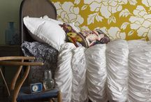 Bedding, Curtains and Tufted Ottomans