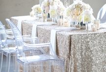 """Grand Romance / For many 2015 weddings, we'll see a return to classic elegance and romance. For a fresh twist, take the glamour of classic """"old Hollywood"""" styling and inject a splash of modern sass and sparkle.  Dramatic gowns with a hint of color • sparkly sashes • lovely linens and formal dining • crystal headbands • veils • candelabras • elegant cakes • lavish fabrics • hanging crystals • formal floral arrangements • custom lighting • lots of glittering blush-gold touches • champagne towers"""