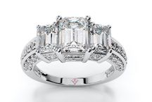 Three-Stone Engagement Rings / An engagement ring that represents the past, present & future. The perfect ring to symbolize the strength of love.