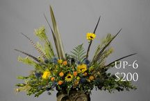 Urn and Picture Arrangements / One thing we pride ourselves in is the ability to photoshop, enlarge, and print images of your loved ones for a funeral.  I incorporate the image into a flower arrangement.  A favorite for cremation ceremonies.
