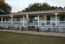 Mobile Home Porch Designs / Whether you have a mobile, manufactured, or RV home, you still love a great porch! Mobile home porches offer all of the advantages of traditional porches and can add both comfort and beauty - see for yourself!  #mobilehomeporches #mobilehomeimprovementideas