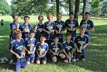Soccer / My first soccer coaching experience.  11 and 12 year old boys.  Varying sizes and skills.  We started slow in in the fall but finished strong.  We kept playing indoor against strong competion in the winter.  Then we put it altogether in the spring.  The guys won their league and went undefeated for the spring season.  Booyah! / by Chris Kelley