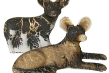 African Creative Ceramic Animals / A unique, ceramic collection of African animals with flair and creativity that make them stand out as being uniquely African. With a crackled glaze, flashed metallic and blackened carbon surfaces.