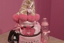 "Diaper Cakes BY Diaper Diva Creations / Impress the Mommy-to-be with a ""Diaper Cake"" that is Beautifully Unique and Elegant. It will show your Love, Thoughtfulness and Originality. Our diaper cakes is guarantee to be a hit, steal the show and have everyone talking!"