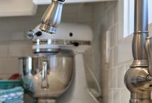 It's all in the details / Crisp white kitchen with white subway tile backsplash. The budget friendly light fixtures with bling add sparkle to this family friendly kitchen.