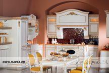 Rosa / Кухня ROSA создана для тех, кто не идет на компромисс. Утончённая отделка, теплота натурального дерева — в этом она следует современным тенденциям мебельной моды, сохраняя при этом верность классическим формам и материалам.  Роскошный резной декор фасадов, подчеркнутый серебряной или золотой патиной, балюстрады, колонны с массивными резными капителями, благородство цветовой гаммы выделяет эту изысканную кухню во всём модельном ряде.