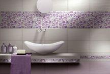 """Feinstes italienisches Glasmosaik Vetro Vivo und KerBin / Einzigartig in der Welt, VETROVIVO präsentiert originelle und patentierte Glasmosaike, zeitlos realisiert in vielfältigen Formen und Farben. Ob das """"Wunder"""" aus Glassplittern, Margeriten in goldenen Tönen, Brick oder Squarry in geraden Linien oder doch ein kunstvoller Bonsai als Wandbild, innovative Kostbarkeiten """"Made in Italy"""". Leuchtend wie exklusive Juwelen, Oberflächen glatt oder geschnitzt in glänzenden und matten Farben ist dieses Glasmosaik ein Symbol von Helligkeit und Klarheit,"""