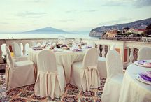 Sorrento Wedding Venues / Set high above the Bay of Naples, home to lemon orchards providing the fruit for the city's famous limoncello, Sorrento's beautiful location has drawn visitors for centuries. The gateway to the Amalfi Coast, you can see out to the island of Capri, while Vesuvius and Monte Faito make a dramatic frame to the red-roofed white houses rising up from the sea.