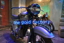 The Gold Factory : 3 Showroom Inauguration at Salt Lake / The Gold Factory 3 - Expect these when you come shopping here 1. Electric Pantograph mirrors. 2. Conveyar belt display counter. 3. Dumb waiter for service. 4. Rough-shuttered concrete. 5. Classic British Motorbikes. 6. Ceramic Art installation. 7. Open space for events.