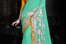 Elegant Sarees / Beautiful Georgette Saris designed with elegant  border length and contrasting blouse