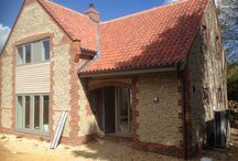 Pipin House / New build Norfolk flint fronted house with Rationel Aldus windows and doors