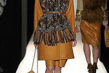 LFW ¬ Mulberry / It was a stimulating mix of textures for the Mulberry show. There was a lot of fur going on, along with leather and chunky knit scarves tucked into waist belts. General cosy goodness! / by Zuneta Beauty