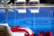 Swimming pool.! / Lounge by the turquoise pool of Thalassa Hotel.!