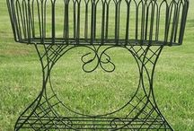 Garden Plants & Flower Potholders / Wrought iron garden plants and potholders to keep the flowers carrying your favorite blooms and colors.