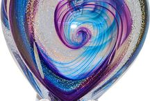 "Heart Memorials / The feel of this heart in your hands gives a feeling of connection and comfort.  These pieces are a beautiful combination of dichroic glass made from precious metals, specially formulated glass color and the ashes of your loved one. The heart is handmade in our studio in Seattle by a team of artisans who have created 12,000 memorials with care and diligence. The heart is approximately 3 ½"" x 3 ½"" and weighs a about 16 ounces."