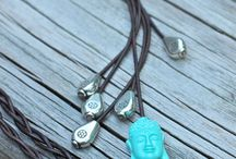 Long leather charm necklace / by Jane Faraco